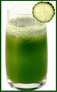 Glass of cucumber juice and slice of a cucumber on a white background