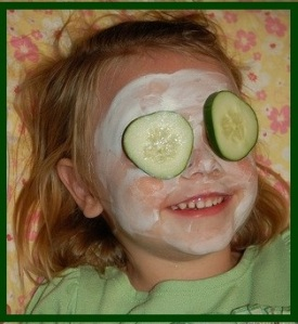 little girl with cucumber on her eyes